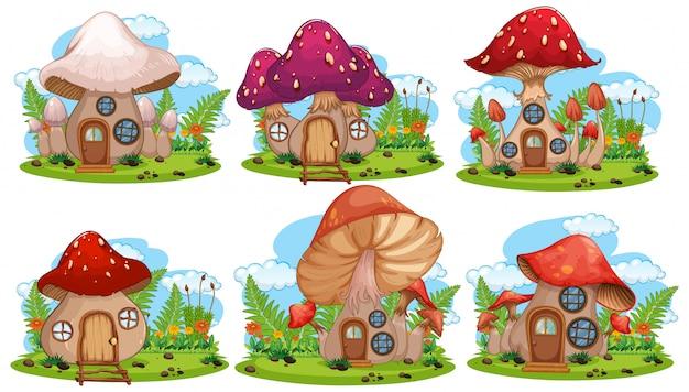 Ensemble de maison de fée aux champignons isolé