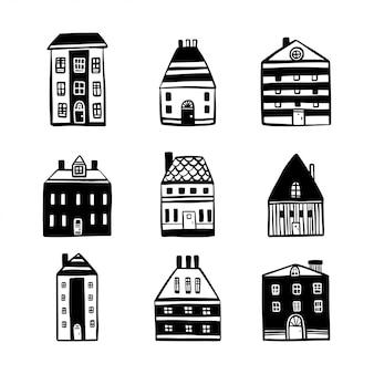 Ensemble de maisons de dessin animé dessinés à la main.