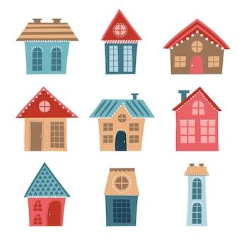 Ensemble de maisons drôles de dessin animé au design plat sur fond blanc. bleu et rouge