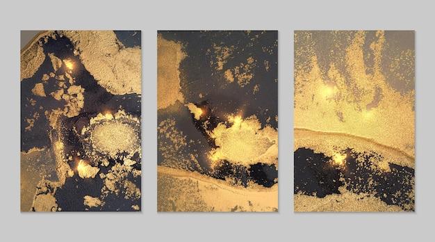 Ensemble en marbre d'arrière-plans abstraits gris noir et or avec des paillettes dans la technique d'encre à l'alcool