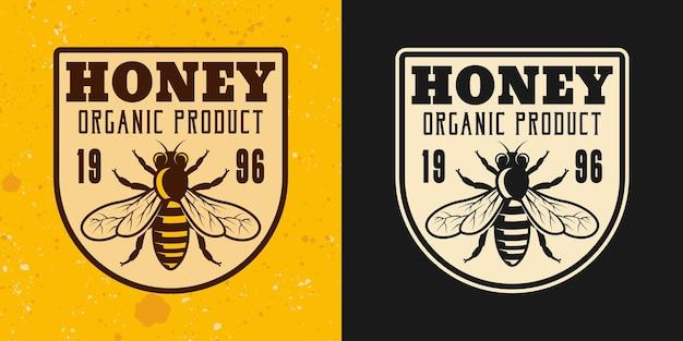 Ensemble de miel et d'apiculture de deux styles vectoriels emblème, insigne, étiquette ou logo sur fond jaune et foncé