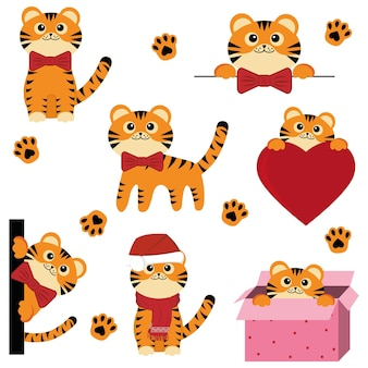 Ensemble de mignons petits tigres de noël, vecteur de couleur isolé illustration de style dessin animé