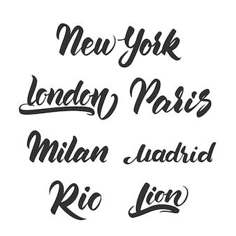 Ensemble de modèle de lettrage dessiné à la main pour l'emblème des villes