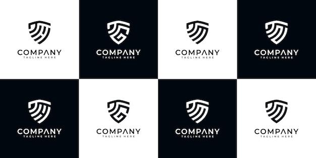 Ensemble de modèle de logo créatif lettre bouclier.