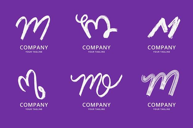 Ensemble de modèles de logo m peints à la main