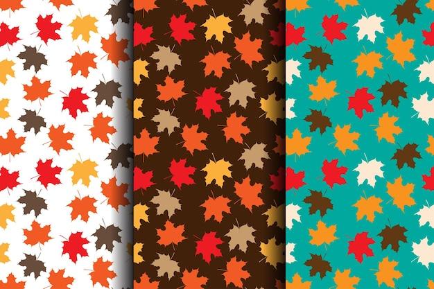 Ensemble de modèles sans couture d'automne avec des feuilles jaunes et oranges rouges