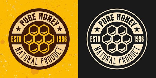 Ensemble en nid d'abeille de deux styles de vecteur emblème, insigne, étiquette ou logo sur fond jaune et foncé