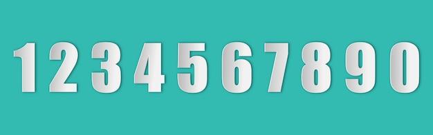 Ensemble de nombres dans un style papier avec une ombre réaliste sur le fond vert