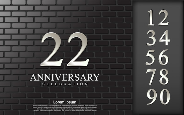 Ensemble de nombres pour la célébration avec fond de brique.