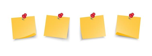Ensemble de notes autocollantes jaunes de bureau avec des épingles.