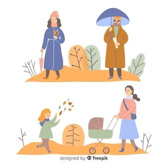 Ensemble de personnes dans le parc en automne