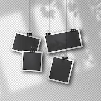 Ensemble de photos suspendues dans un style vintage sur fond transparent doux. modèles photo rétro réalistes suspendus sur des clips métalliques. superposition d'ombre organique douce de la fenêtre et de l'environnement.
