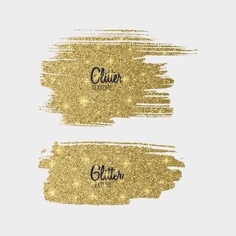 Ensemble de pinceaux à paillettes dorées isolé sur blanc