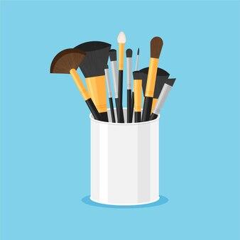 Ensemble de pinceaux professionnels purs noirs pour le maquillage dans un verre