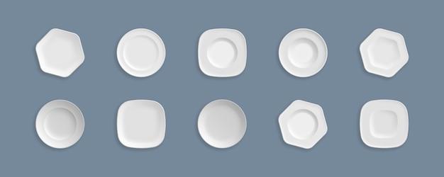 Ensemble de plats propres blancs, bols. verrerie, ustensiles de cuisine.