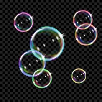 Ensemble de plusieurs bulles de savon colorées translucides sur transparent