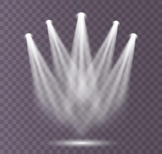 Un ensemble de projecteurs blancs brille sur la scène, le podium.