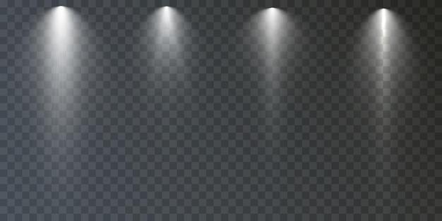 Ensemble de projecteurs isolé sur fond transparent effet de lumière rougeoyante de vecteur