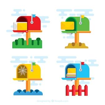 Ensemble de quatre boîtes aux lettres de couleur dans le design plat