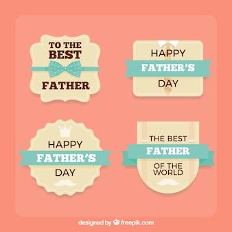 Ensemble de quatre étiquettes de jour de père avec des rubans bleus