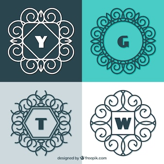 Ensemble de quatre monogrammes décoratifs