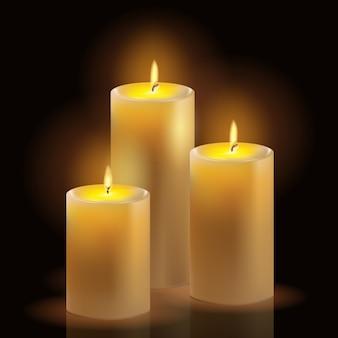 Ensemble réaliste de bougies à la cire brûlante.
