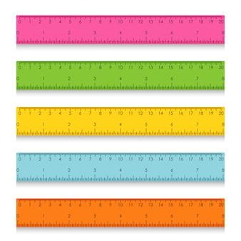 Ensemble de règles de mesure scolaires multicolores avec centimètres et pouces. illustration