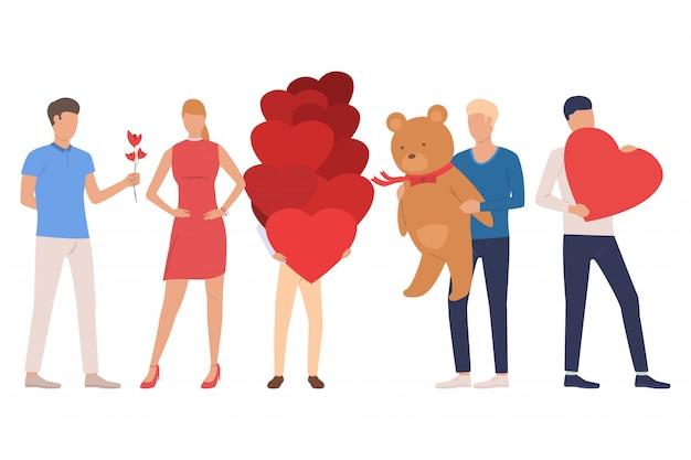 Ensemble de rencontres. hommes et femmes tenant un ours en peluche