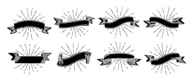 Ensemble rétro de ruban doodle. rubans dessinés à la main de gravure ancienne noire. ruban avec des rayons lumineux. collection de grunge antique, vierge.