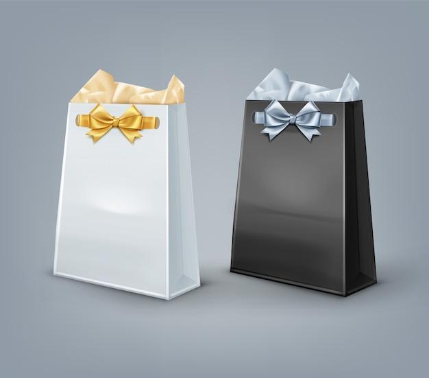 Ensemble de sacs-cadeaux en papier noir et blanc avec des bols isolés sur fond