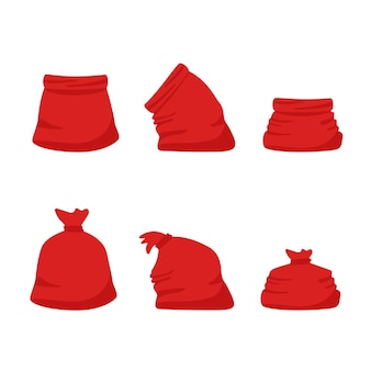 Ensemble de sacs rouges santa claus isolé sur fond blanc.