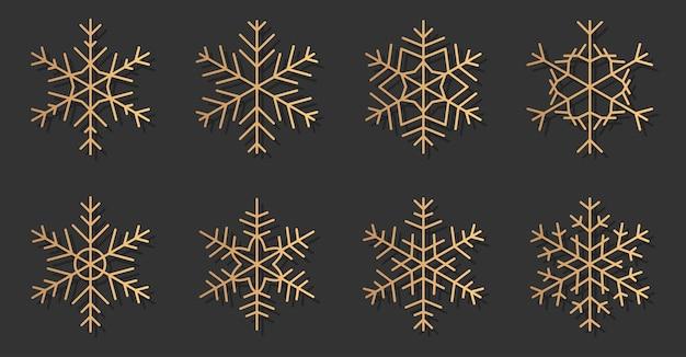 Ensemble de silhouettes élégantes d'icônes de flocons de neige or. différentes formes de neige à la mode, dorées