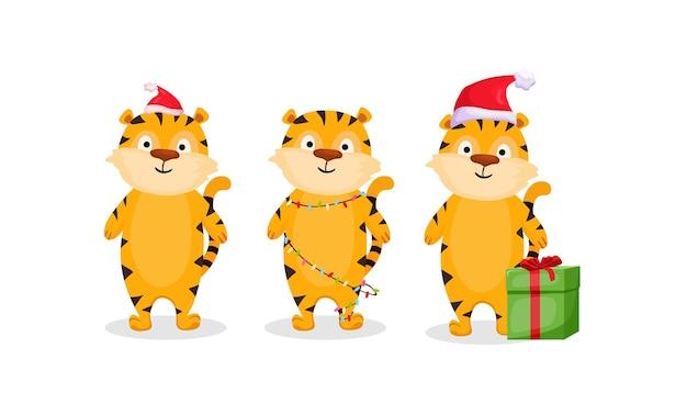 Un ensemble de tigres de noël de bande dessinée dans une guirlande, un chapeau et avec un cadeau. illustration vectorielle.