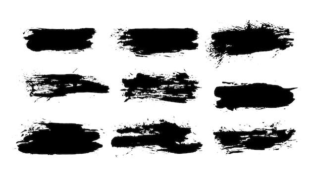 Ensemble de traits de pinceaux grunge, coups de peinture avec un pinceau sec. taches d'encre abstraites