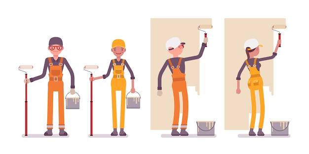Ensemble de travailleurs masculins et féminins peinture, vêtu d'une combinaison lumineuse