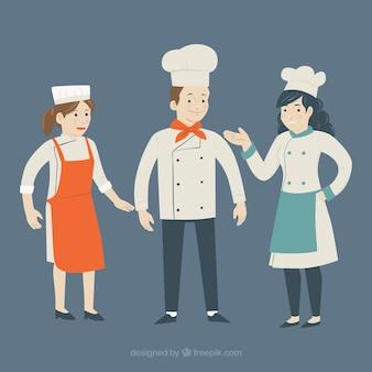 Ensemble de trois cuisiniers souriants