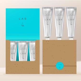 Ensemble de tubes de crème pour les mains en argent ou métallisé vector flip over boîte d'emballage en papier kraft recyclé