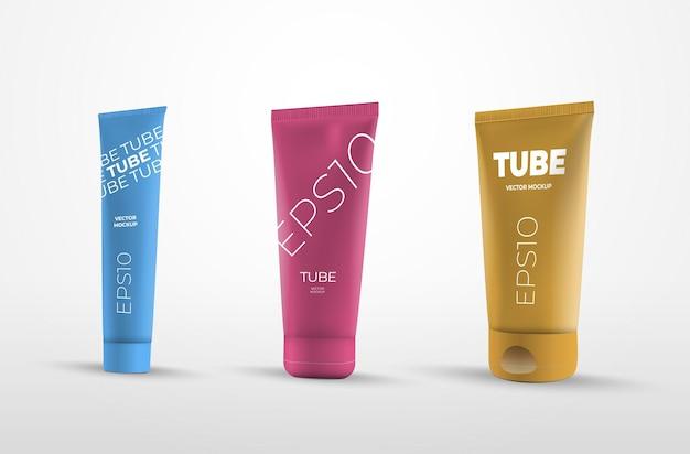 Ensemble de tubes vectoriels isolés sur fond blanc en jaune, rose et bleu. modèle de conteneur court, moyen et long pour la présentation de la conception. emballage de maquette pour crème et lotion