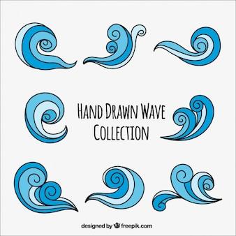 Ensemble de vagues dessinés à la main avec des remous
