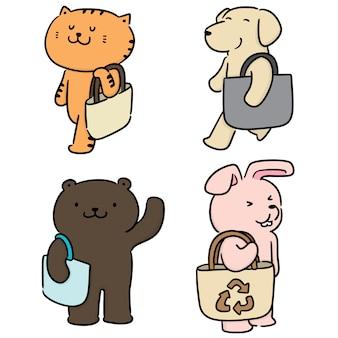 Ensemble de vecteur d'animal portant sac en tissu