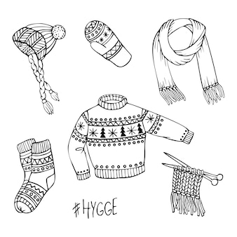 Ensemble de vecteur dessiné à la main de vêtements tricotés.