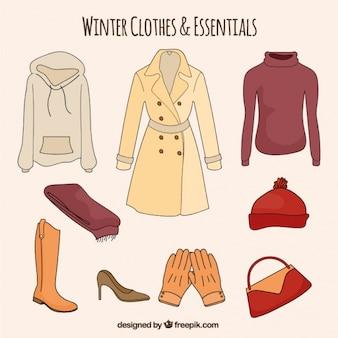 Ensemble de vêtements et les éléments essentiels d'hiver dessinés à la main