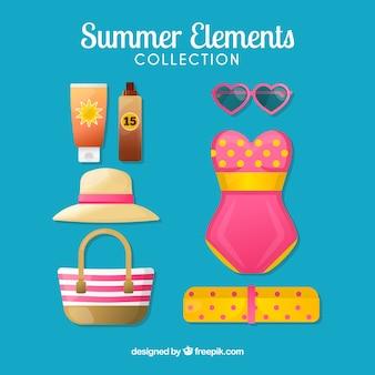 Ensemble de vêtements d'été et d'éléments dans un style plat