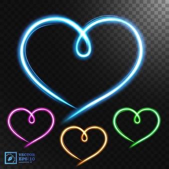 Ensembles d'effets de mouvement de lumière en forme de coeur, isolés sur un motif transparent.