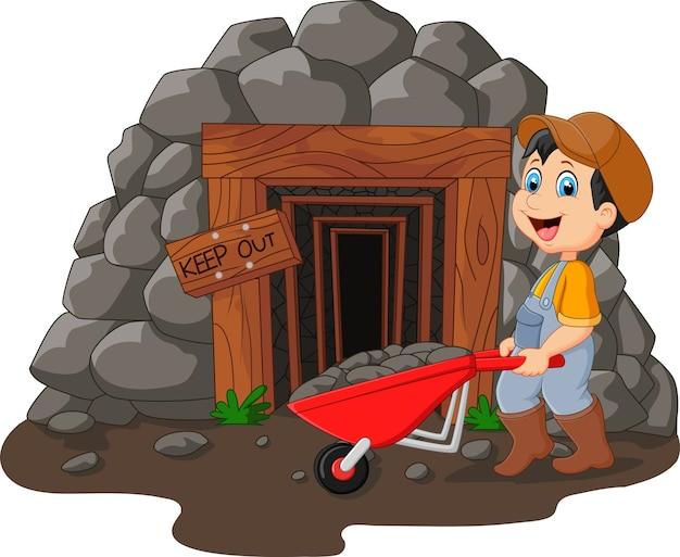 Entrée de la mine de dessin animé avec un mineur en possession d'une pelle