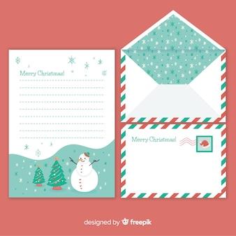 Enveloppe et lettre de noël avec motif de flocons de neige
