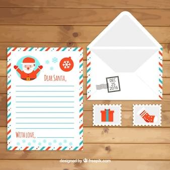 Enveloppe avec le père noël lettre de noël et timbres