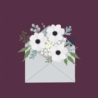 Enveloppe postale avec des fleurs romantiques.