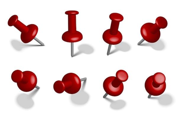 Épingles rouges stationnaires en papier dans différentes vues. isolé