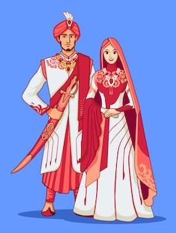 Épouses pakistanaises avec la robe traditionnelle rose.
